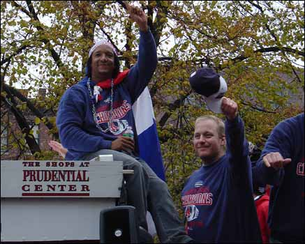 Alex G. grabbed a great shot of Pedro Martinez and Curt Schilling tipping their hats to the fans along the parade route.