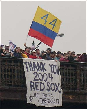 Fans hang the Colombian flag from the Longfellow bridge. Shortstop Orlando Cabrera is a Colombian native.