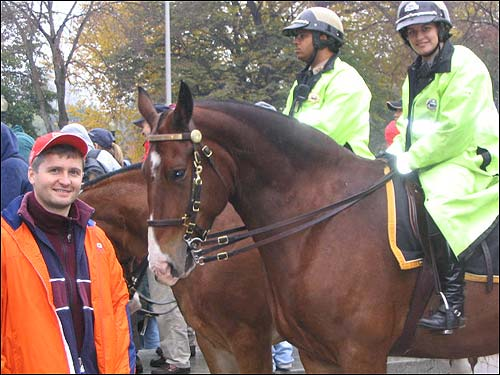 Pawel Nowakowski poses alongside the police horses.