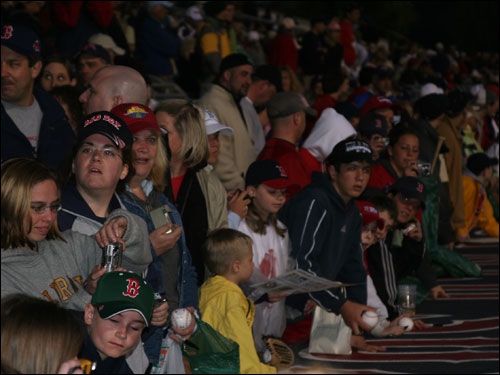 It seemed like everyone at the park was armed with either something to sign or a digital camera as fans anxiously awaited their first glimpse of the World Series champs before the start of last night's opener.
