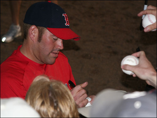 Sox third baseman Kevin Youkilis obliged the Fort Myers faithful by stepping out to sign a few balls, hats, and programs for fans that surrounded the Red Sox dugout before last night's game.