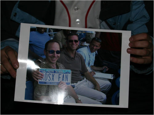 Deb has all the essentials for the double overnighter, including her prized possession of Yankees GM Brian Cashman and his Sox fan license plate seated with Sox GM Theo Epstein and assistant to the GM Jed Hoyer at Fenway.