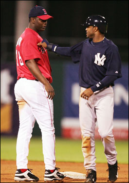Tony Womack nudges Edgar Renteria after Womack was caught stealing last night.
