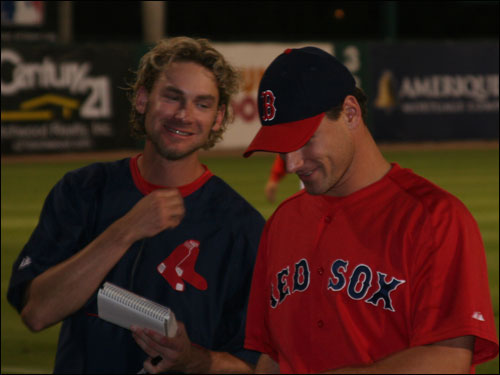 Sox pitchers Bronson Arroyo and Lenny DiNardo appease the autograph hounds who are wild about getting something signed by the world champs before every spring game.