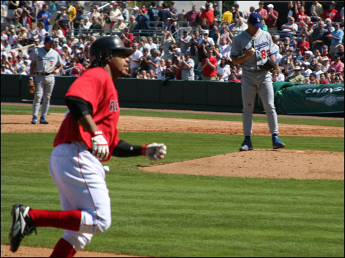 Manny Ramirez rounds the bases after homering.