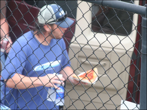 Mark Bellhorn enjoys two slices of pizza to go along with his two RBI doubles on the afternoon before boarding the van back to Ft. Myers.