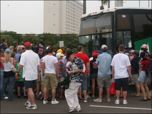 Who needs the Rolling Stones at Fenway when the Beatles play there 81 times a year. Once again fans mob the Sox bus hoping to get something signed by a player before they skip town.
