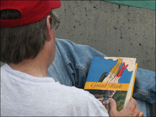 The book that Stephen King can't stop reading, even in his seat at City of Palms Park, is 'Great Neck' by Jay Cantor.