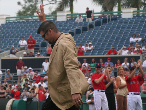 Jason Varitek acknowledges the applause after he steps out of the dugout in his new look, complete with sandals courtesy of the 'Queer Eye' gang.