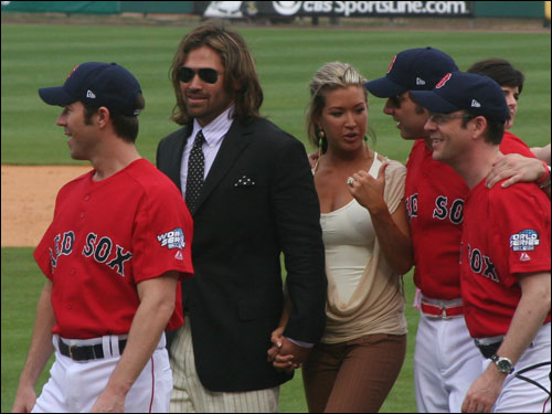 Johnny Damon and his wife Michelle accompany the 'Queer Eye' gang off the field after Wednesday's post-game ceremony.