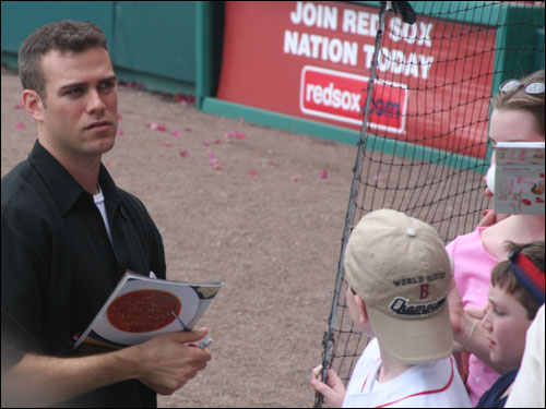 Sox GM Theo Epstein came out on the field for the 'Queer Eye' post-game wrap up and signed a few autographs for the fans.