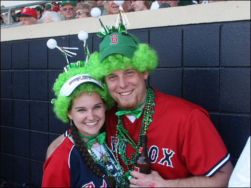 Wendy Ann Whalen from Providence and Scott Rugby of Concord, N.H., get into the spirit of the day.