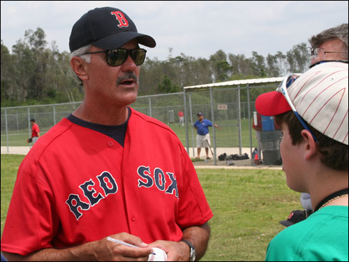 Minor league complex fixture Dwight Evans, who looks like he could step right into right field for the Sox, takes time out to sign autographs for the fans.