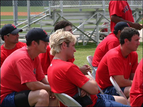 Sox minor leaguers take a break from working out to watch some of the major leaguers take part in some game action at the Red Sox training complex.