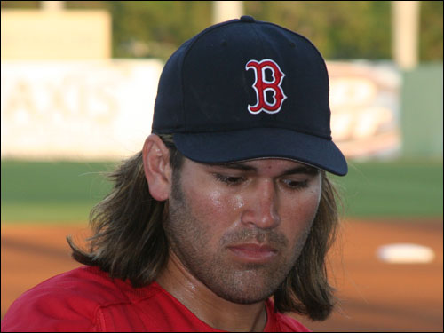 Clean-shaven Johnny Damon was back in the house against the Reds last night after a week-long bout with cellulitis. At the plate, Damon's timing was off on most of his swings as the self-proclaimed rock star went 0-for-3 on the night.