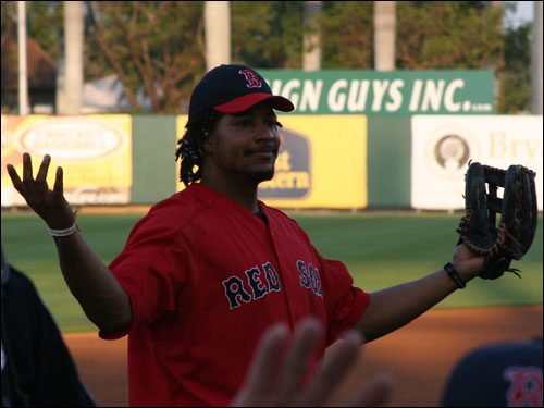 Manny Ramirez jokes around with fans before the game against the Reds in Ft. Myers.