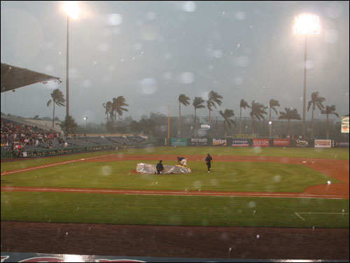 The wind and rain rushed into Ft. Myers in the seventh inning, causing the fans to scramble for cover and the game to eventually be called.