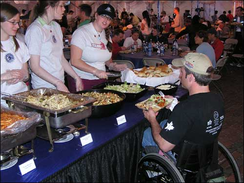 Wheelchair entrant Matt Davis, of Bowling Green, Ky., received his pasta dinner in preparation for his first Boston Marathon.