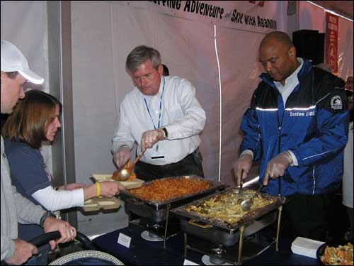Mike Galvin, chief of Boston city services (left) and former New England Patriot Gavin Veris, now the Boston director of recreation, dished out pasta at the pre-race dinner.