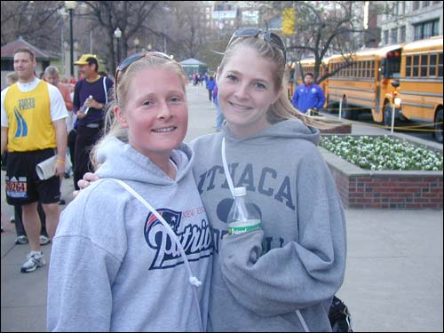 Cape Cod sisters Mackenzie Sisson (left), 24, and Rebecca, 23, are running the Boston Marathon for the second time. They're hoping that it's not too hot today.