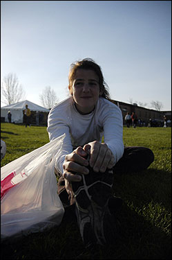Lindsey Pete, 19, of Philadelphia, stretched near the start of the race in Hopkinton in preparation for the marathon. She has raised $2,000 for the charity Next Step.