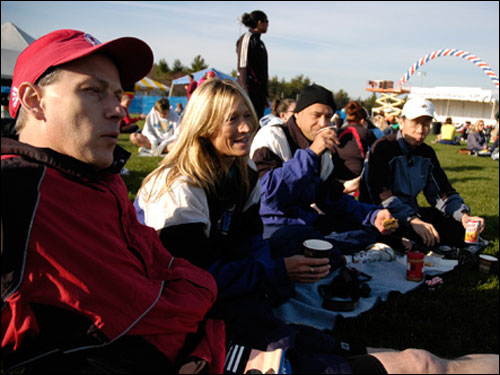 """Left to right, Marty Halin, Christa Winslow, David Winslow, and Bong Joon Yoon are all marathon veterans, having run a combined 50 marathons between them. """"There's a 70-degree difference between training temperature and today!"""" said Yoon. They'd prefer mid-40-degree weather, as would most runners."""