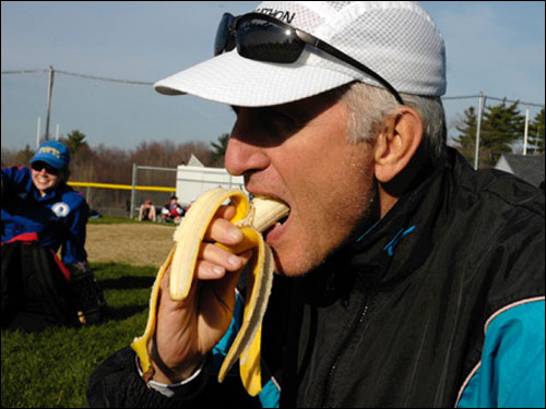 "Ted Braggins, 62, from Edina, Minn., ate 3 bananas before the race. This will be the 138th marathon for Braggins, and his 6th Boston Marathon. ""The biggest challenge is just getting here, qualifying,' he said."