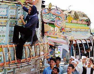 Angelina Jolie climbing truck