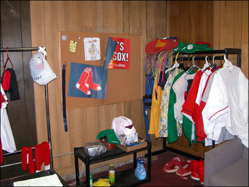 The glamour of professional sports? Not exactly. This is the changing room for the ball attendants, which they share with the Red Sox mascot, Wally.