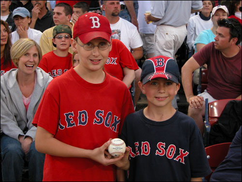 One heroic 11-year-old. Michael Frydayk (left) got a foul ball from our correspondent, and gave it to his 7 year-old cousin. Paul Frydayk. Michael admitted he already had a ball from batting practice.