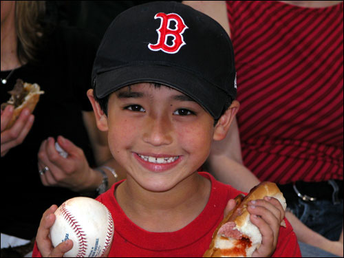A foul ball, a hot dog, a Sox game at Fenway ... and a big grin on the face of 7-year-old Ethan Wang. Priceless.