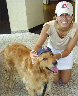 Georgia, pet of George Regan from Regan Communications, poses with employee Marzi Alavi.