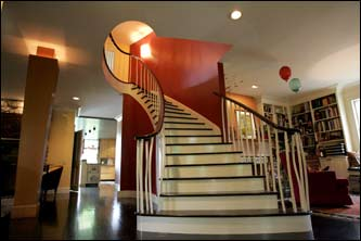 The center entrance includes unusual lines and crooked bamboo railings on the staircase.
