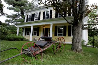 She kept the front of her house traditional, including a breaking down carriage.