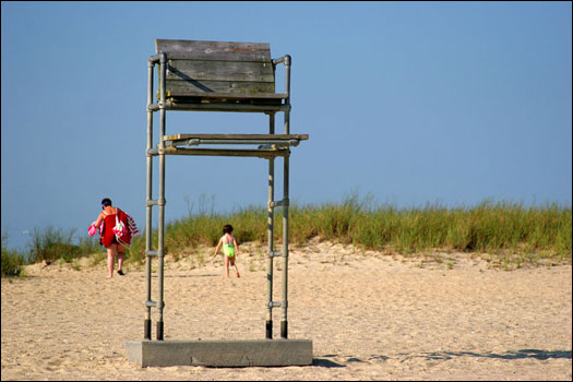A weathered lifeguard chair sits empty at Veterans Park, in Hyannis. Veterans Park