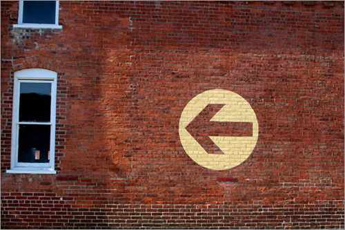 Arrows guide visitors to the main entrance at Mass MoCA.
