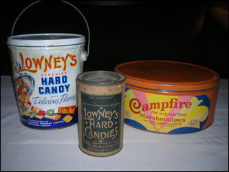 When Kevin Lowney of Weymouth searched his name on the Internet, what he found surprised him. A man with the same last name as his started a now thriving chocolate company over 100 years ago. That is when his fever for Lowney's Chocolates merchendise started. Old candy containers are great to come by. The two on the left sell hard candy, the one on the right is for 'Campfire Marshmallows The Original Food'.