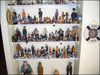 Jim Crawford of Bridgewater, N.H., collects sea captains. In fact, he owns 176 of them, collected over 20 years, that range in size from a 1' figure in a tiny bottle to a 30' captain. Some are carved from wood, others are metal; some are actually bottle stoppers or book ends, others are salt and pepper shakers or refrigerator magnets.