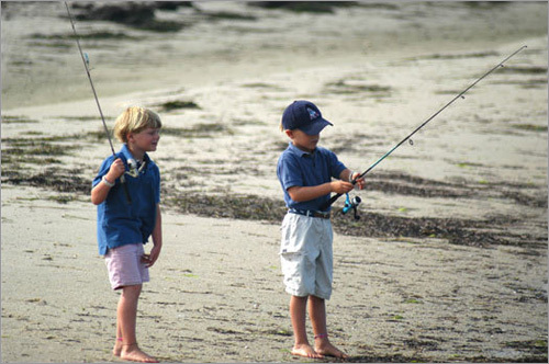Children prepare to cast their lines into the Head of the Harbor waters.