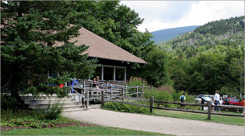 My hike started when I pulled into the Pinkham Notch visitor's center, a couple miles up Route 16 from Jackson, New Hampshire, at shortly after noon. I scanned the sky, looking for the summit, but was disappointed to see that it was shrouded in clouds – as it often is Mt. Washington sits at the confluence of three major storm paths, and the summit regularly records some of the harshest weather in the world. Recorded wind speeds peak as high 230 mph, summer snowfalls are not uncommon, the weather changes in an instant and strong winds are par for the course. All that, and it's still one of New England's most popular mountains to climb.