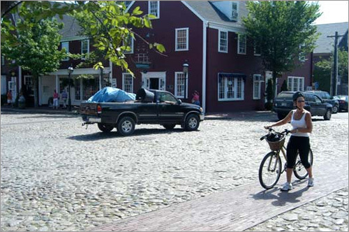 The streets around Nantucket Town (the main port which all ferries arrive and depart) are mostly cobblestones, making bike riding and driving around the area a very bumpy experience. The sidewalks and crosswalks are laid with brick. Bicycles must be walked on brick pathways, can only be ridden on streets, and riders must obey all traffic regulations.