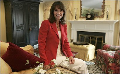 WCVB anchor Liz Brunner sits in her living room that is painted with bright, yet warm, colors.