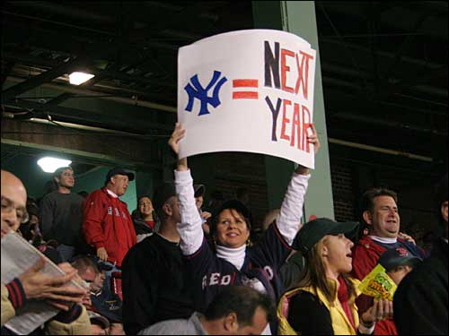 A Red Sox fan held up a sign that read 'New York = Next Year.'