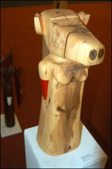 Donna Dodson's hand-carved wooden statues were perched around the room.