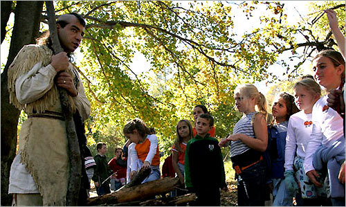 Plimoth Plantation staff members are all Wampanoag or other Native American descendents, and provide oral histories of the site for museum visitors.
