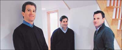 Adam Weiner (left), Randall Goldstein (center), and Todd Finard in the home they created in Brighton for five women with disabilities. ''Everything was done as a team,'' says Weiner.