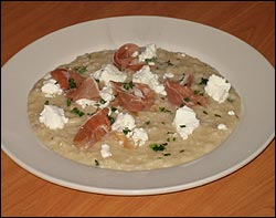 White risotto with thyme, sliced prosciutto, and goat cheese