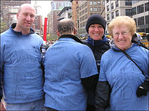 Martha Sostre brought her blue-shirted support team with her from Waukegan, Ill. -- her brother James Vandervoort, husband Ivan Sostre (who shaved her number, 10313, in his hair), and mom Joyce Vandervoort.