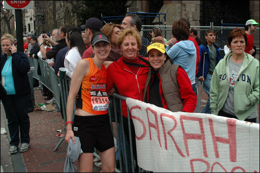 Sarah Roccio of Stoughton (L) met with friends Suzanne Hundley of Sorono and Karen Orband of Boxford about half a block from the finish line.