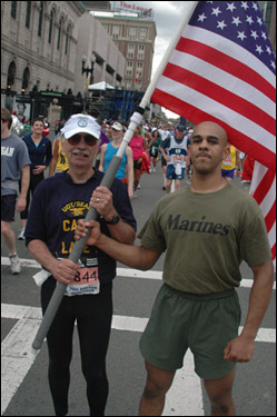 James Lake (L) and Christopher Mix of Virginia finished the marathon together, holding the American flag for the entire race.